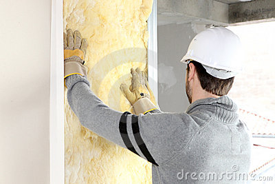 Craftsman insulating a wall