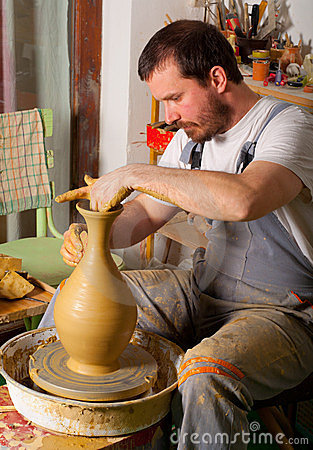 Craftsman making vase from fresh wet clay