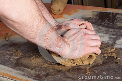 Craftsman preparing clay