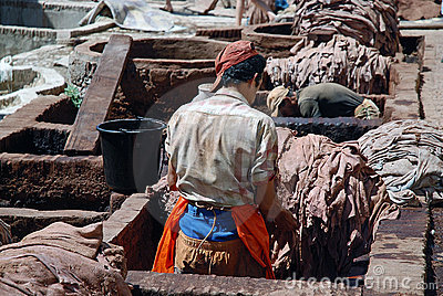 Craftsmen at a leather tannery, Morocco Editorial Stock Photo