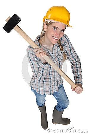 Craftswoman holding a hammer