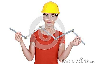 Craftswoman holding ruler
