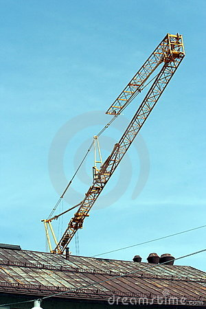 A crane behind a roof