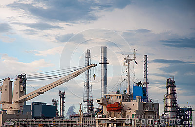Crane on Boat at Oil refinery factory in Thailand