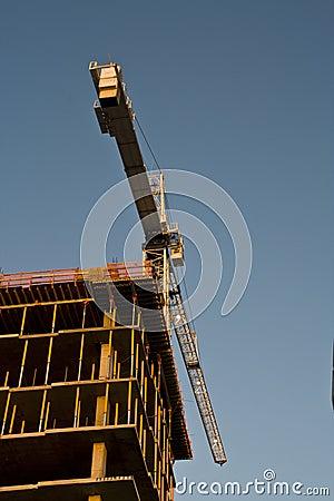 Crane building a tall building