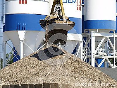 Crane dropping gravel