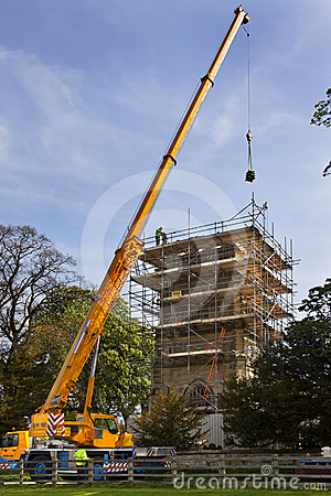 Crane Lifting Masonary - Church Roof Restoration  Editorial Stock Photo