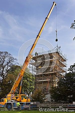 Crane Lifting Masonary - Church Roof Restoration  Editorial Stock Photo