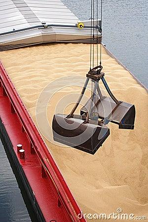Crane unloading a barge