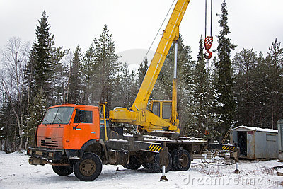Crane working in the woods in winter