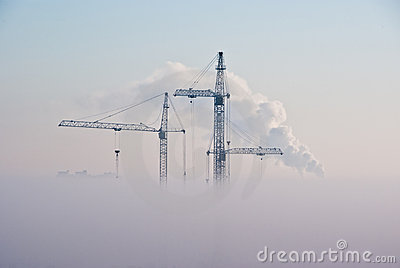 Cranes in clouds