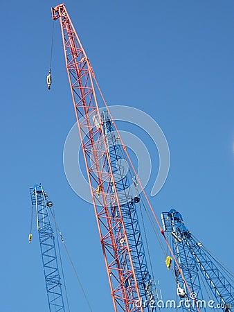 Cranes with derricks