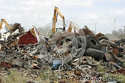 Cranes Moving Waste at the Scrap Yard