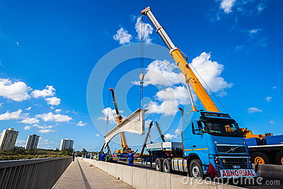 Cranes Lifting Heavy Bridge Section Editorial Photography