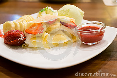 Crape with banana, strawberry and ice cream