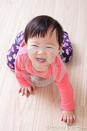Crawling baby girl smile