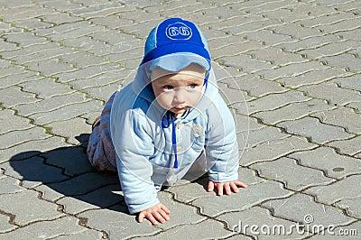Crawling baby on paving stone