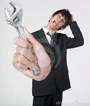 Crazy businessman holding wrench