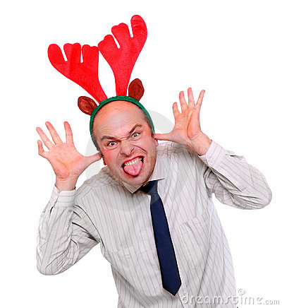 Crazy businessman with rudolph reindeer attire.