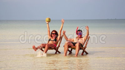 Crazy couple sunbathing inside fantastic crystal water. Koh rong island, cambodia stock video footage