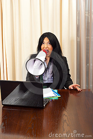 Crazy manager woman shouting in megaphone