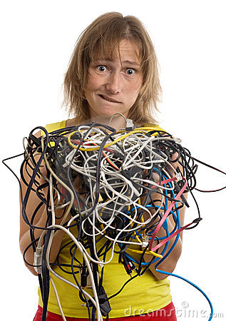 Crazy woman with tangle of cables