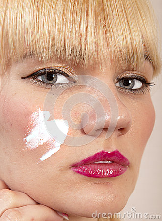 Cream on face
