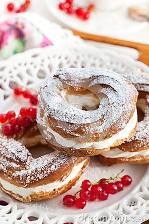 Free Cream Puff Rings Decorated With Fresh Red Currant Stock Image - 44066531