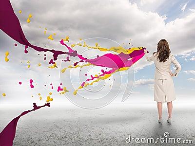 Creative businesswoman with paints splash