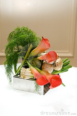 Creative centerpiece with vegetables and foliage