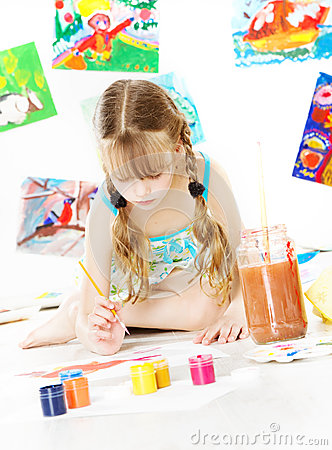 Creative child drawing with color brush