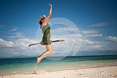 Creative girl happy jump at tropical beach