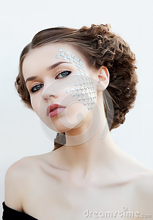 Creative make up. Bright young girl face close up