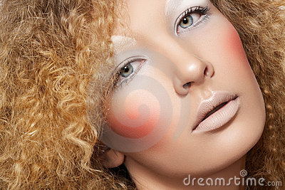 Creative style. Model with curly hair, fun make-up