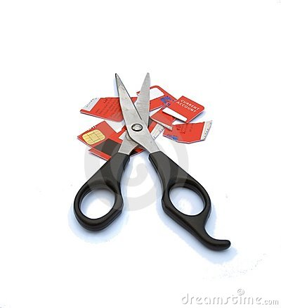 Credit card cut up with big scissors.