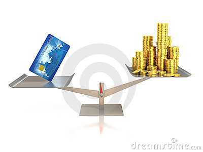 Credit card and golden coins on balance scale