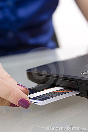 Free Credit Card Inserted In Laptop Stock Photo - 18969030