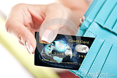 Credit card in woman s hand taken out from wallet