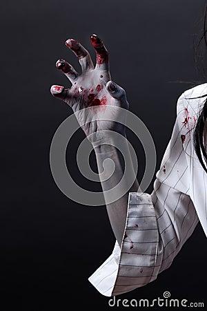 Creepy bloody zombie hand