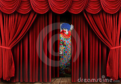 Creepy Clown Looking Through Stage Curtain Drapes