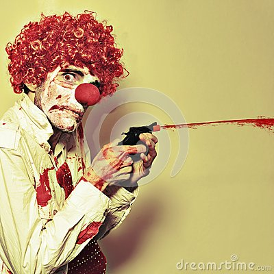 Creepy Manic Clown Shooting Blood From Cap Gun
