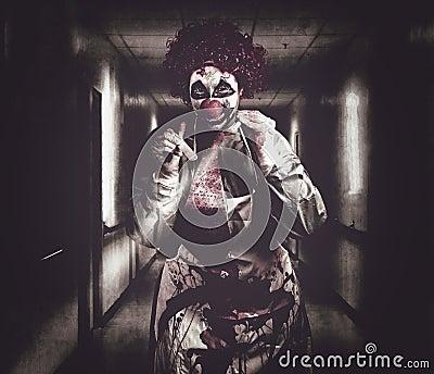 Creepy medical clown in grunge hospital hallway