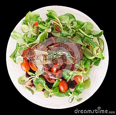 Cremalheira de cordeiro fritada rara no preto