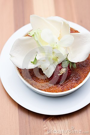 Creme brulee decorate with white petals