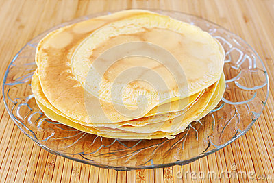 Crepes on glass plate