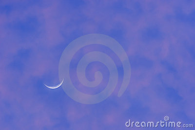 Crescent moon in purple sky
