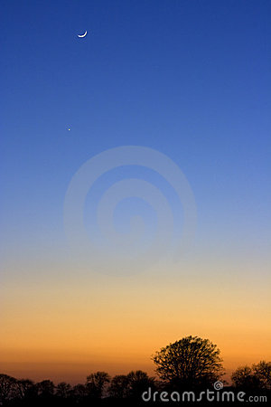 A crescent moon at sunset
