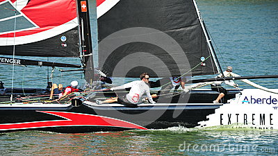 Crew of Alinghi team steering boat at Extreme Sailing Series Singapore 2013 Editorial Image