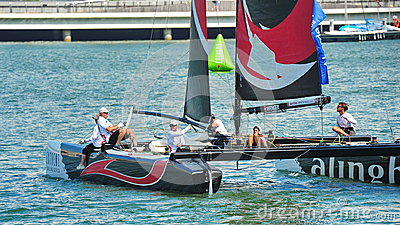 Crew of Alinghi team steering boat at Extreme Sailing Series Singapore 2013 Editorial Stock Photo
