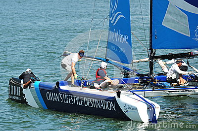 Crew of Wave Muscat steering boat at Extreme Sailing Series Singapore 2013 Editorial Stock Image